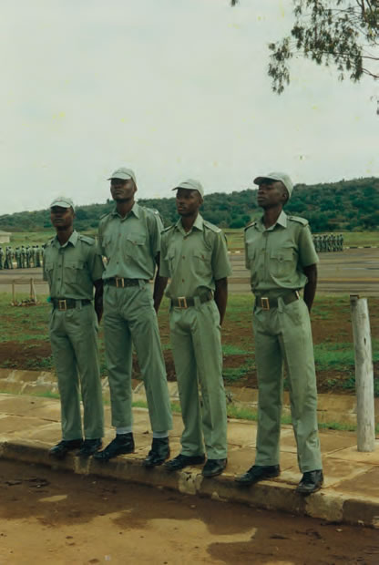 At the National Youth Service, Gilgil, 1986, being punished for leading a 'riot' in Ngamia Barracks. From left to right: Chome Mwidau, The Candidate, Ojwang' Hongo and B. F. Odhiambo Onienga.